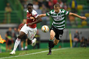 Danny Welbeck of Arsenal and Stefan Ristovski of Sporting CP clash during the UEFA Europa League Group E match between Sporting CP and Arsenal at Estadio Jose Alvalade on October 25, 2018 in Lisbon, Portugal.