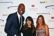 (L-R) Former NBA player and radio host John Salley, model Leeann Tweeden, and Natasha Duffy attend the 28th Anniversary Sports Spectacular Gala at the Hyatt Regency Century Plaza on May 19, 2013 in Century City, California.