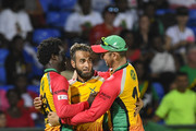 In this handout image provided by CPL T20, Chadwick Walton (L), Imran Tahir (C) and Cameron Delport (R) of Guyana Amazon Warriors celebrate during match 19 of the Hero Caribbean Premier League between St Kitts & Nevis Patriots and Guyana Amazon Warriors at the Warner Park Sporting Complex on August 25, 2018 in Basseterre, St Kitts, Saint Kitts And Nevis.