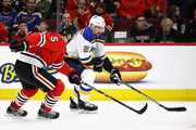 Patrik Berglund #21 of the St. Louis Blues advances the puck under pressure from Connor Murphy #5 of the Chicago Blackhawks.at the United Center on March 18, 2018 in Chicago, Illinois.