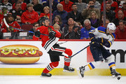John Hayden #40 of the Chicago Blackhawks and Brayden Schenn #10 of the St. Louis Blues collide going for the puck at the United Center on March 18, 2018 in Chicago, Illinois.