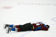 Patrick Bordeleau #58 of the Colorado Avalanche lies on the ice after suffering a hit by Brenden Morrow #10 of the St. Louis Blues at Pepsi Center on March 8, 2014 in Denver, Colorado. The Blues defeated the Avalanche 2-1.