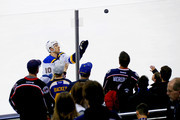 Brayden Schenn #10 of the St. Louis Blues throws a puck into the stands for a fan during pregame warmups prior to the start of the game against the Columbus Blue Jackets on March 24, 2018 at Nationwide Arena in Columbus, Ohio.