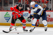Adam Henrique #14 of the New Jersey Devils battles for the puck in the second period against Colton Parayko #55 of the St. Louis Blues on November 7, 2017 at Prudential Center in Newark, New Jersey.