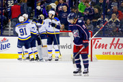 Artemi Panarin #9 of the Columbus Blue Jackets skates off the ice as Colton Parayko #55 of the St. Louis Blues and Vladimir Tarasenko #91 of the St. Louis Blues congratulate each other after defeating the Columbus Blue Jackets 2-1 on March 24, 2018 at Nationwide Arena in Columbus, Ohio.