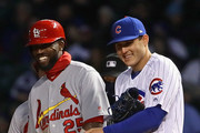 Dexter Fowler #25 of the St. Louis Cardinals and Anthony Rizzo #44 of the Chicago Cubs share a laugh after Fowler drew a walk.in the 2nd inning at Wrigley Field on April 17, 2018 in Chicago, Illinois.