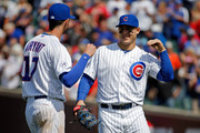 Anthony Rizzo #44 of the Chicago Cubs and Kris Bryant #17 celebrate their win over the St. Louis Cardinals at Wrigley Field on July 7, 2015 in Chicago, Illinois. The Chicago Cubs won 7-4.