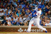 Anthony Rizzo #44 of the Chicago Cubs hits an RBI double against the St. Louis Cardinals to score Victor Caratini #7 (not pictured) during the fifth inning at Wrigley Field on July 19, 2018 in Chicago, Illinois.