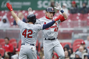 Harrison Bader #48 of the St. Louis Cardinals celebrates with teammate Greg Garcia #35 after hitting a two-run home run in the second inning of the game against the Cincinnati Reds at Great American Ball Park on April 15, 2018 in Cincinnati, Ohio. All players are wearing #42 in honor of Jackie Robinson Day.