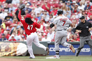 Johnny Cueto #47 of the Cincinnati Reds gets to first base ahead of Matt Holliday #7 of the St. Louis Cardinals in the third inning of the game at Great American Ball Park on September 11, 2014 in Cincinnati, Ohio.