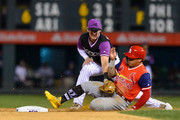 Ryan McMahon #24 of the Colorado Rockies tags out Kolten Wong #16 of the St. Louis Cardinals on a steal attempt in the eighth inning of a game  during Players' Weekend at Coors Field on August 24, 2018 in Denver, Colorado. Players are wearing special jerseys with their nicknames on them during Players' Weekend.