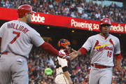 Oscar Taveras #18 of the St. Louis Cardinals is congratulated by Matt Holliday #7 after scoring a run against the San Francisco Giants during the third inning at AT&T Park on July 2, 2014 in San Francisco, California.