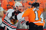 Patrick Sharp #10 of the Chicago Blackhawks fights with Ian Laperriere #14 of the Philadelphia Flyers in Game Three of the 2010 NHL Stanley Cup Final at Wachovia Center on June 2, 2010 in Philadelphia, Pennsylvania.