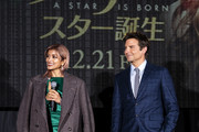 Model Rola (L) and actor Bradley Cooper attend the 'A Star Is Born' Japan premiere at Roppongi Hills on December 11, 2018 in Tokyo, Japan.