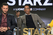 Pablo Schreiber (L)  and Orlando Jones of 'American Gods' speak onstage during Starz 2019 Winter TCA Panel & All-Star After Party on February 12, 2019 in Los Angeles, California.