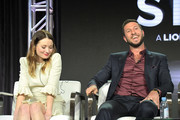 Emily Browning (L) and Pablo Schreiber of 'American Gods' speaks onstage during Starz 2019 Winter TCA Panel & All-Star After Party on February 12, 2019 in Los Angeles, California.