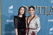 "(L-R) Mishel Prada and Melissa Barrera attend the Starz Premiere event for ""Outlander"" Season 5 at Hollywood Palladium on February 13, 2020 in Los Angeles, California."