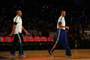 Stephen Curry #30 of the Golden State Warriors and of the Western Conference walks with his father and NBA Legend Dell Curry during the Degree Shooting Stars Competition as part of the 2015 NBA Allstar Weekend at Barclays Center on February 14, 2015 in the Brooklyn borough of New York City. NOTE TO USER: User expressly acknowledges and agrees that, by downloading and or using this photograph, User is consenting to the terms and conditions of the Getty Images License Agreement.