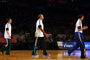 Stephen Curry #30 of the Golden State Warriors and of the Western Conference walks with his father and NBA Legend Dell Curry and Sue Bird #10 of the Seattle Storm during the Degree Shooting Stars Competition as part of the 2015 NBA Allstar Weekend at Barclays Center on February 14, 2015 in the Brooklyn borough of New York City. NOTE TO USER: User expressly acknowledges and agrees that, by downloading and or using this photograph, User is consenting to the terms and conditions of the Getty Images License Agreement.