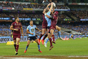 Josh Morris of the Blues catches the ball to score a try against Greg Inglis of the Maroons (L) and Johnathan Thurston during game two of the State of Origin series between the New South Wales Blues and the Queensland Maroons at the Melbourne Cricket Ground on June 17, 2015 in Melbourne, Australia.