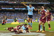 Josh Morris of the Blues celebrates a try against Greg Inglis of the Maroons (L) and Johnathan Thurston during game two of the State of Origin series between the New South Wales Blues and the Queensland Maroons at the Melbourne Cricket Ground on June 17, 2015 in Melbourne, Australia.