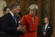 Conservative MP and former prime minister Theresa May (R) talks with Britain's Transport Secretary Grant Shapps (L) in the Central Lobby as they walk back to the House of Commons after the Queen's Speech during the State Opening of Parliament at the Palace of Westminster on October 14, 2019 in London, England. The Queen's speech is expected to announce plans to end the free movement of EU citizens to the UK after Brexit, new laws on crime, health and the environment.