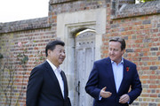 British Prime Minister David Cameron welcomes Chinese President Xi Jinping to his official residence at Chequers on October 22, 2015 in Aylesbury, England. The President of the Peoples Republic of China, Mr Xi Jinping and his wife, Madame Peng Liyuan, end a State Visit to the United Kingdom as guests of The Queen.  They stayed at Buckingham Palace and undertook engagements in London and Manchester. The last state visit paid by a Chinese President to the UK was Hu Jintao in 2005.