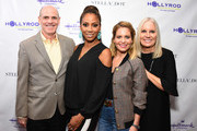 Bill Abbott, Holly Robinson Peete, Candace Cameron Bure and Michelle Vicary attend the Stella & Dot x HollyRod Foundation Charity Trunk Show for Autism Awareness Month on April 11, 2018 in Los Angeles, California.