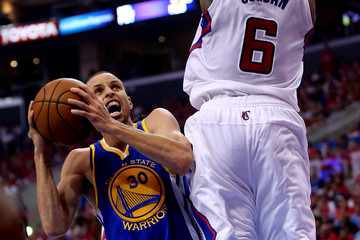 Stephen Curry DeAndre Jordan Golden State Warriors v Los Angeles Clippers - Game One