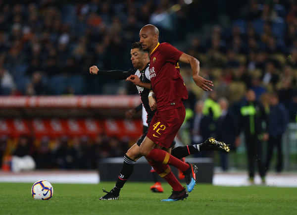 AS Roma vs. Juventus - Serie A [player,sports,sports equipment,football player,team sport,ball game,soccer player,football,tournament,sport venue,as roma,juventus,serie a,serie a match between as roma,rome,italy,steven nzonzi of as roma,cristiano ronaldo of juventus,stadio olimpico]