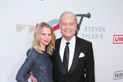 (L-R) Kayte Walsh and Kelsey Grammer arrive at Steven Tyler's Third Annual Grammy Awards Viewing Party to benefit Janie's Fund presented by Live Nation at Raleigh Studios on January 26, 2020 in Los Angeles, California.