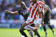Wilfried Zaha of Crystal Palace tackles Glen Johnson of Stoke City during the Premier League match between Stoke City and Crystal Palace at Bet365 Stadium on May 5, 2018 in Stoke on Trent, England.