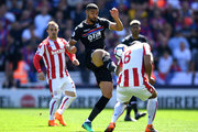 Glen Johnson of Stoke City challenges Ruben Loftus-Cheek of Crystal Palace during the Premier League match between Stoke City and Crystal Palace at Bet365 Stadium on May 5, 2018 in Stoke on Trent, England.
