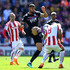 Glen Johnson Photos - Glen Johnson of Stoke City challenges Ruben Loftus-Cheek of Crystal Palace during the Premier League match between Stoke City and Crystal Palace at Bet365 Stadium on May 5, 2018 in Stoke on Trent, England. - Stoke City vs. Crystal Palace - Premier League