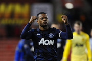 Patrice Evra of Manchester United celebrates at the end of the Capital One Cup Quarter Final match between Stoke City and Manchester United at the Britannia Stadium on December 18, 2013 in Stoke on Trent, England.