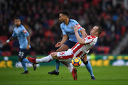 Jacob Murphy of Newcastle United and Charlie Adam of Stoke City in action during the Premier League match between Stoke City and Newcastle United at Bet365 Stadium on January 1, 2018 in Stoke on Trent, England.