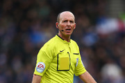 Referee Mike Dean in action during the Barclays Premier League match between Stoke City and Queens Park Rangers at the Britannia Stadium on January 31, 2015 in Stoke on Trent, England.