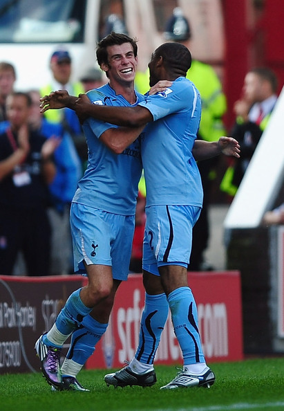 Gareth Bale of Tottenham celebrates his second goal  with Wilson Palacios during the Barclays Premier League match between Stoke City and Tottenham Hotspur at the Britannia Stadium on August 21, 2010 in Stoke on Trent, England.