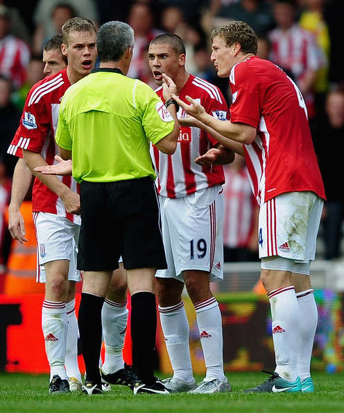 Ryan Shawcross, Jonathan Walter and Robert Huth of Stoke City argue with Referee Chris Foy during the Barclays Premier League match between Stoke City and Tottenham Hotspur at the Britannia Stadium on August 21, 2010 in Stoke on Trent, England.
