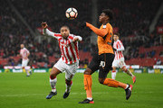 Kortney Hause of Wolverhampton Wanderers and Glen Johnson of Stoke City compete for the ball during The Emirates FA Cup Third Round match between Stoke City and Wolverhampton Wanderers at Bet365 Stadium on January 7, 2017 in Stoke on Trent, England.