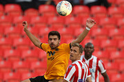 Ruben Neves of Wolverhampton Wanderers heads the ball watched by  Darren Fletcher during the pre-season friendly match between Stoke City and Wolverhampton Wanderers at the Bet365 Stadium on July 25, 2018 in Stoke on Trent, England.