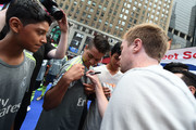 American soccer player Dax McCarty signs autographs during the Street Soccer USA Cup at Times Square on July 9, 2016 in New York City.