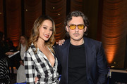 Jamie Chung (L) and Stuart Weitzman Creative Director Giovanni Morelli attend the Stuart Weitzman FW18 Presentation and Cocktail Party at The Pool on February 8, 2018 in New York City.