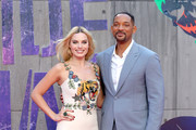 """Margot Robbie and Will Smith attend the European Premiere of """"Suicide Squad"""" at the Odeon Leicester Square on August 3, 2016 in London, England."""