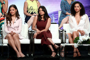 """(L-R) Sarah Jeffery, Melonie Diaz, and Madeleine Mantock from """"Charmed"""" speaks onstage at the CW Network portion of the Summer 2018 TCA Press Tour at The Beverly Hilton Hotel on August 6, 2018 in Beverly Hills, California."""