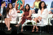 """(L-R) Rupert Evans, Sarah Jeffery, Melonie Diaz, and Madeleine Mantock from """"Charmed"""" speaks onstage at the CW Network portion of the Summer 2018 TCA Press Tour at The Beverly Hilton Hotel on August 6, 2018 in Beverly Hills, California."""
