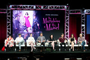 (L-R)  Creator/Executive Producer Amy Sherman-Palladino, Executive Producer Daniel Palladino, and actors Rachel Brosnahan, Tony Shalhoub, Alex Borstein, Michael Zegen, Marin Hinkle, and Kevin Pollak of 'The Marvelous Mrs. Maisel' speak onstage during the Amazon Studios portion of the Summer 2018 TCA Press Tour at The Beverly Hilton Hotel on July 28, 2018 in Beverly Hills, California.