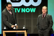 """Magicians Penn Jillette (L) and Teller perform onstage at the """"Fool Us"""" panel during the El Rey Network portion of the 2014 Summer Television Critics Association at The Beverly Hilton Hotel on July 18, 2014 in Beverly Hills, California."""
