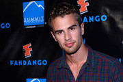 Actor Theo James arrives at Summit Entertainment's press event for the movies 'Ender's Game' and 'Divergent' at the Hard Rock Hotel San Diego on July 18, 2013 in San Diego, California.