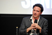 (L-R)  ActorÊAden Young speaks at SundanceTV's presentation of Panel Discussions featuring creators and stars of 'Rectify' and 'The Honorable Woman' on May 16, 2015 in Los Angeles, California.